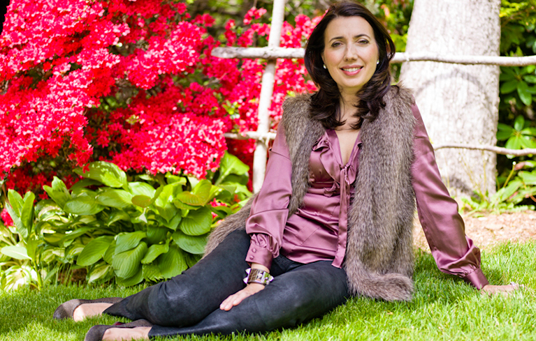 Fran Hauser, President, Digital. Time Inc. Style & Entertainment Group.  Photographed by Amaris Granado. Styled by Dawn Del Russo. Makeup by Vanessa P. A. Evelyn. Clothing: Black pants Alexander Wang. Fur vest (her own). Purple blouse Saks Mall at Short Hill. Lanvin wedges. Hermes bangle (her own).